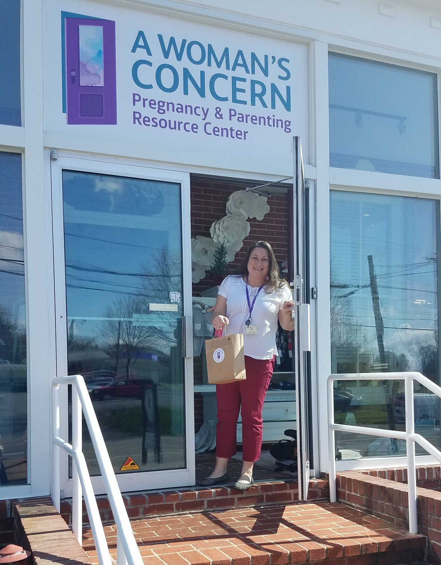 A Woman's Concern Office Manager, Jodi Maurer, as she waits for a client to stop by to pick up diapers