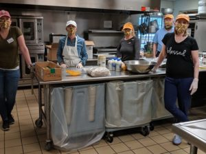 Volunteers wear matching face masks as they prepare a meal for the Anchorage breakfast program. (Photo provided by Anchorage)