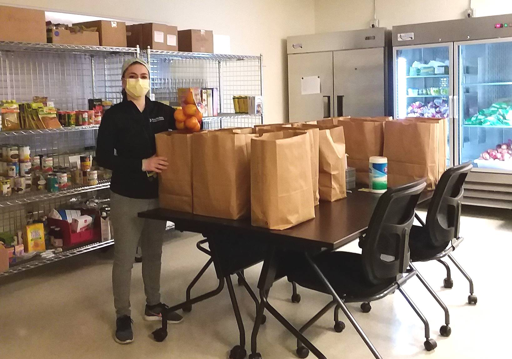 Dietician Laura Sahd wears a mask at the Lancaster County Food Hub. Sahd, of Penn Medicine Lancaster General Health, is community dietician for Food Farmacy, a nutrition counseling pilot program for at-risk individuals. (Photo provided by Lancaster County Food Hub)