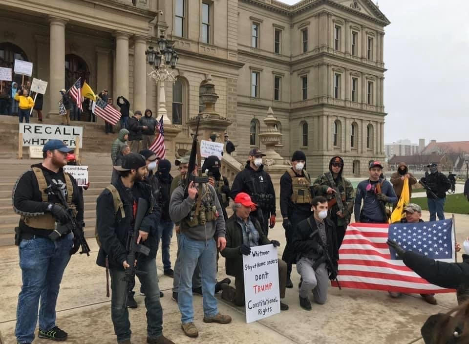 Armed protesters on the steps of Michigan's Capitol on Wednesday, April 15, 2020.
