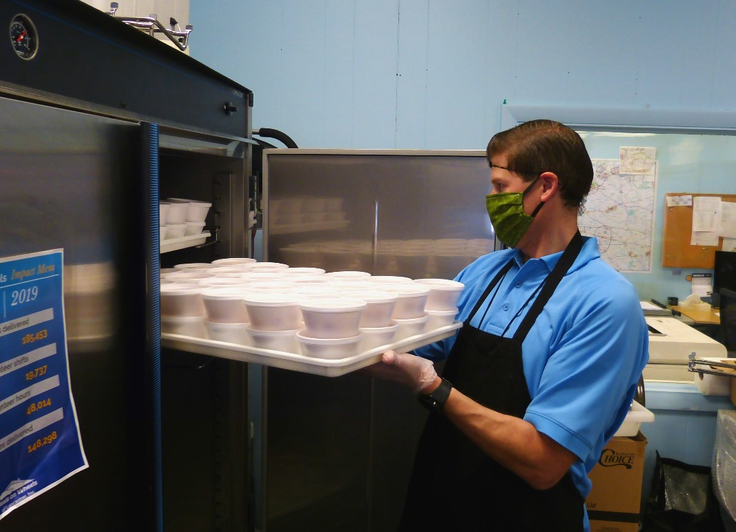 Darin Viergutz slides a tray of pound cake desserts into a refrigerator at Meals on Wheels of Lancaster on Wednesday, May 13, 2020.  (Photo: Tim Stuhldreher)