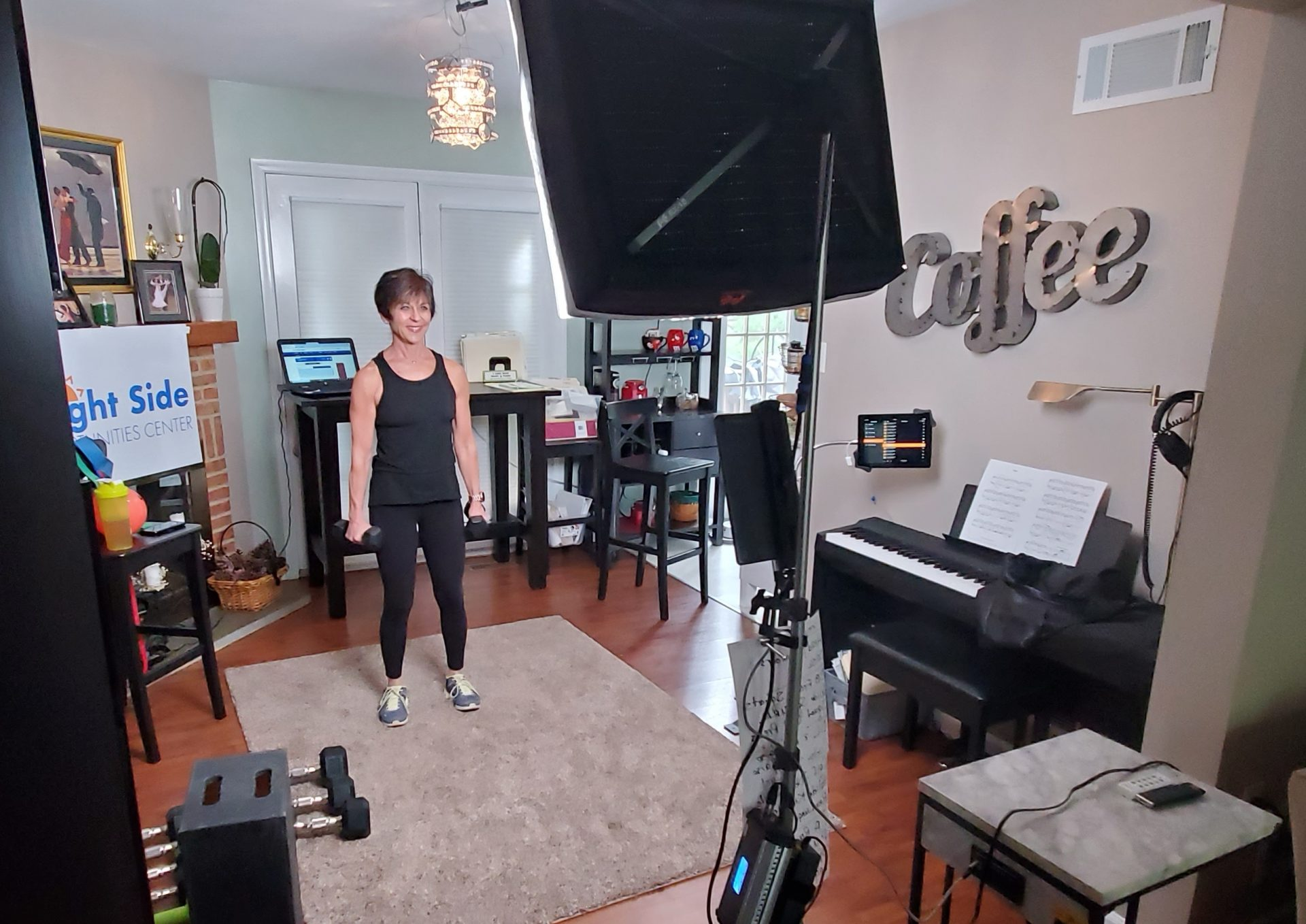Sally Winchell, wellness director at Bright Side Opportunities Center, conducts a Facebook Live fitness class on May 5, 2020. (Source: George Winchell)