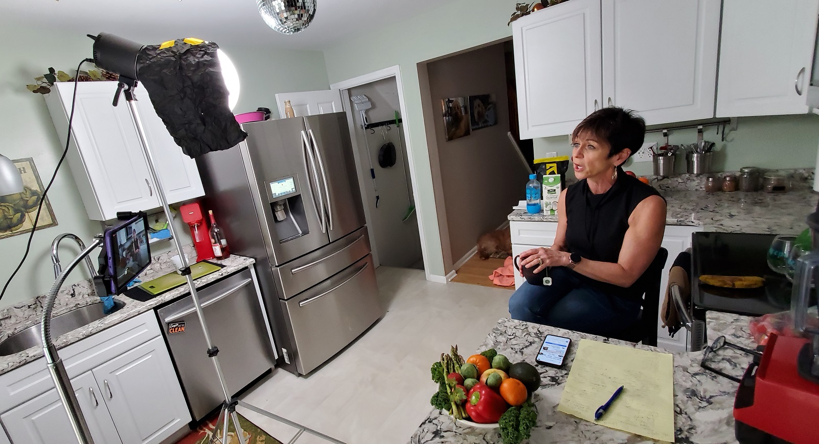 Sally Winchell, wellness director at Bright Side Opportunities Center, conducts an online diet and cooking class from her kitchen. (Source: George Winchell)