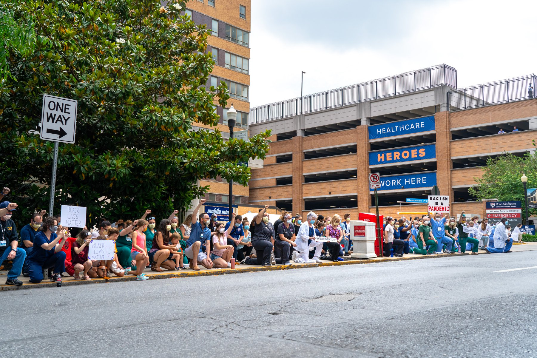 Health care workers kneel outside Lancaster General Hospital in support of Black Lives Matter and to honor victims of racism on Wednesday, June 10, 2020. (Source: Penn Medicine Lancaster General Health)