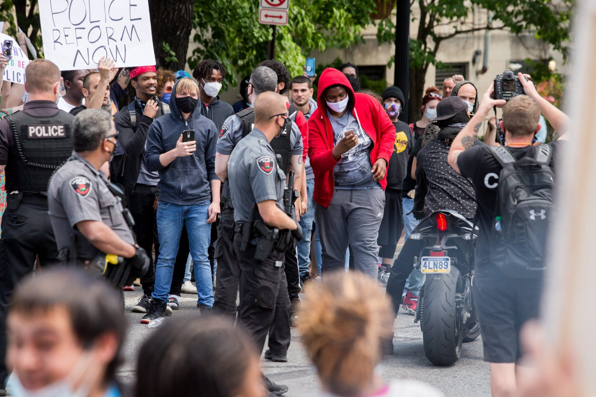 Police and protesters interact at the corner of North Prince and West Chestnut streets in Lancaster on Sunday, May 31, 2020. (Photo: Joyous Snyder)