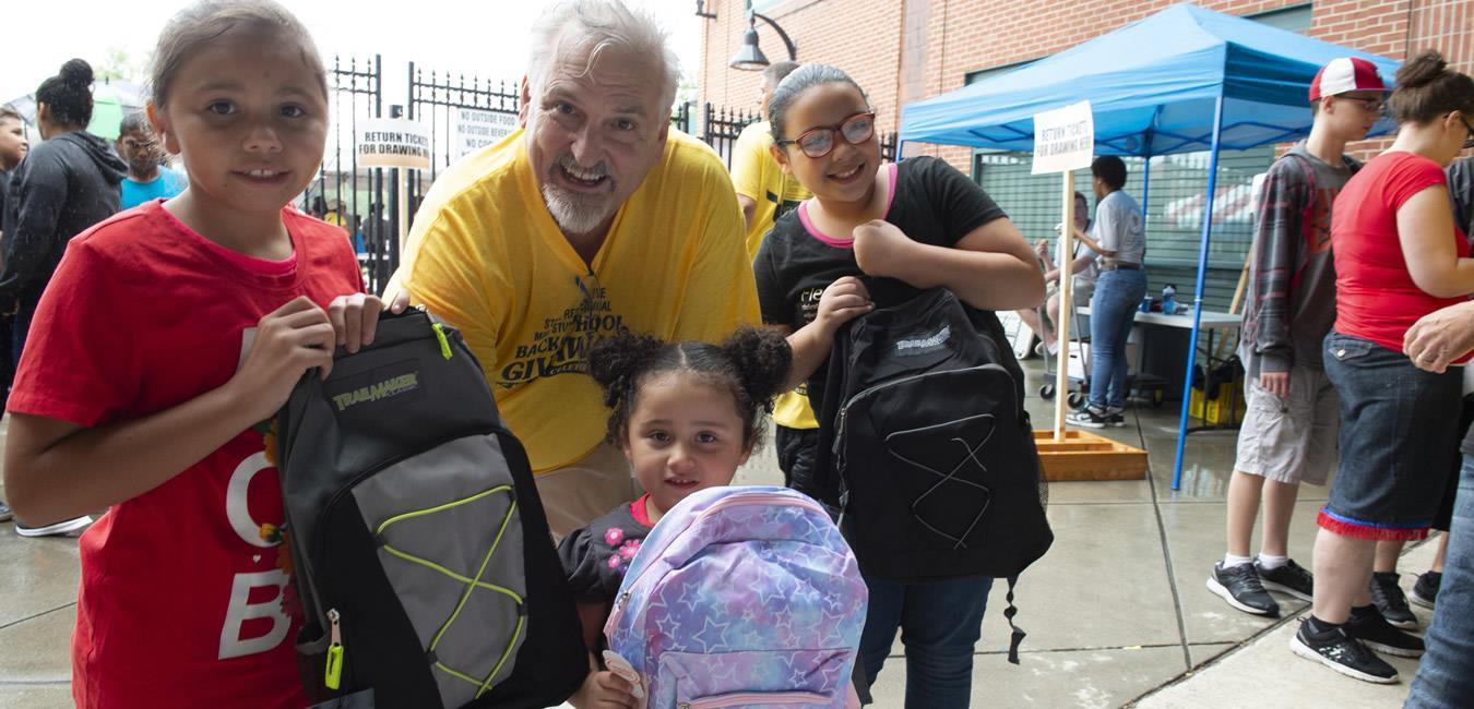 In this undated photo, state Rep. Mike Sturla poses with School District of Lancaster students during the annual Back to School Giveaway at Clipper Magazine Stadium.