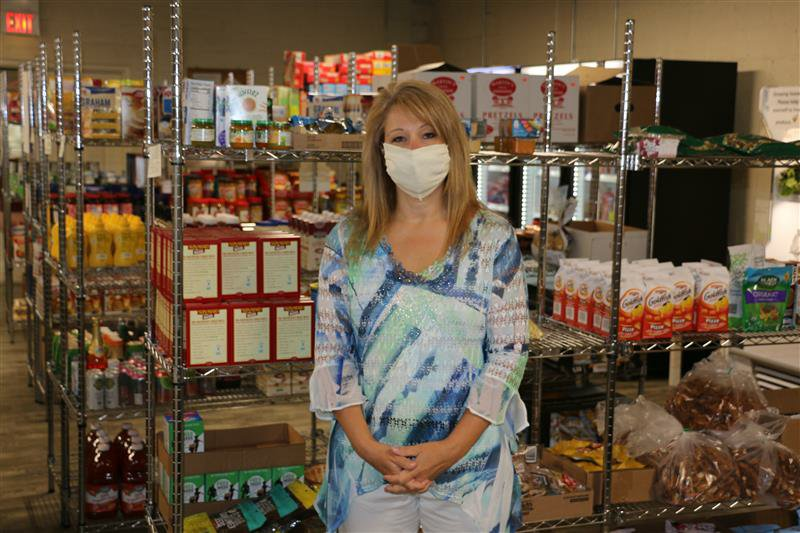 Joy Ashley, executive director at Ephrata Area Social Services, wears a mask at the organization's food bank. (Photo: Kyle Gamble)