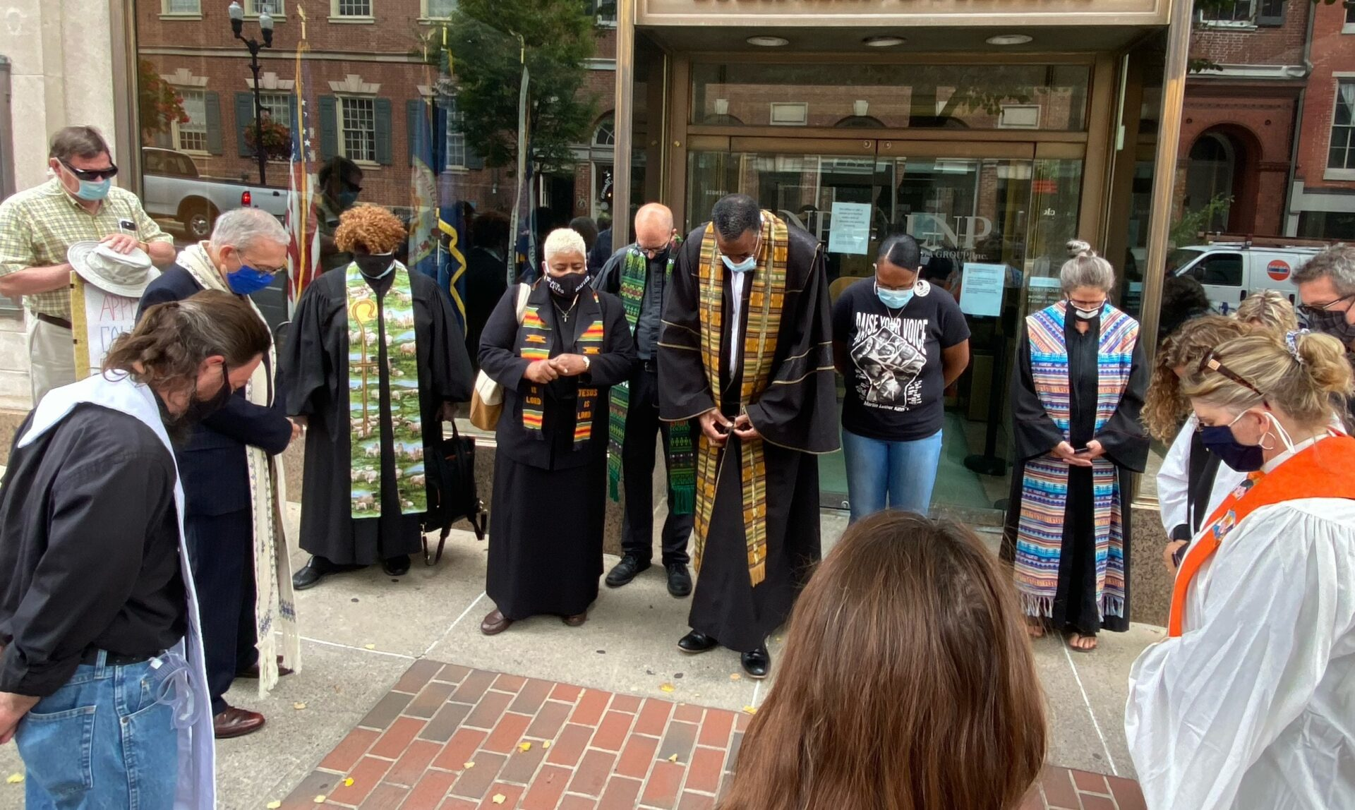 The Rev. Edward Bailey, center, and other clergy pray before marching through Penn Square to Fulton Bank on Thursday, Sept. 17, 2020. (Photo: Audrey Lilley)