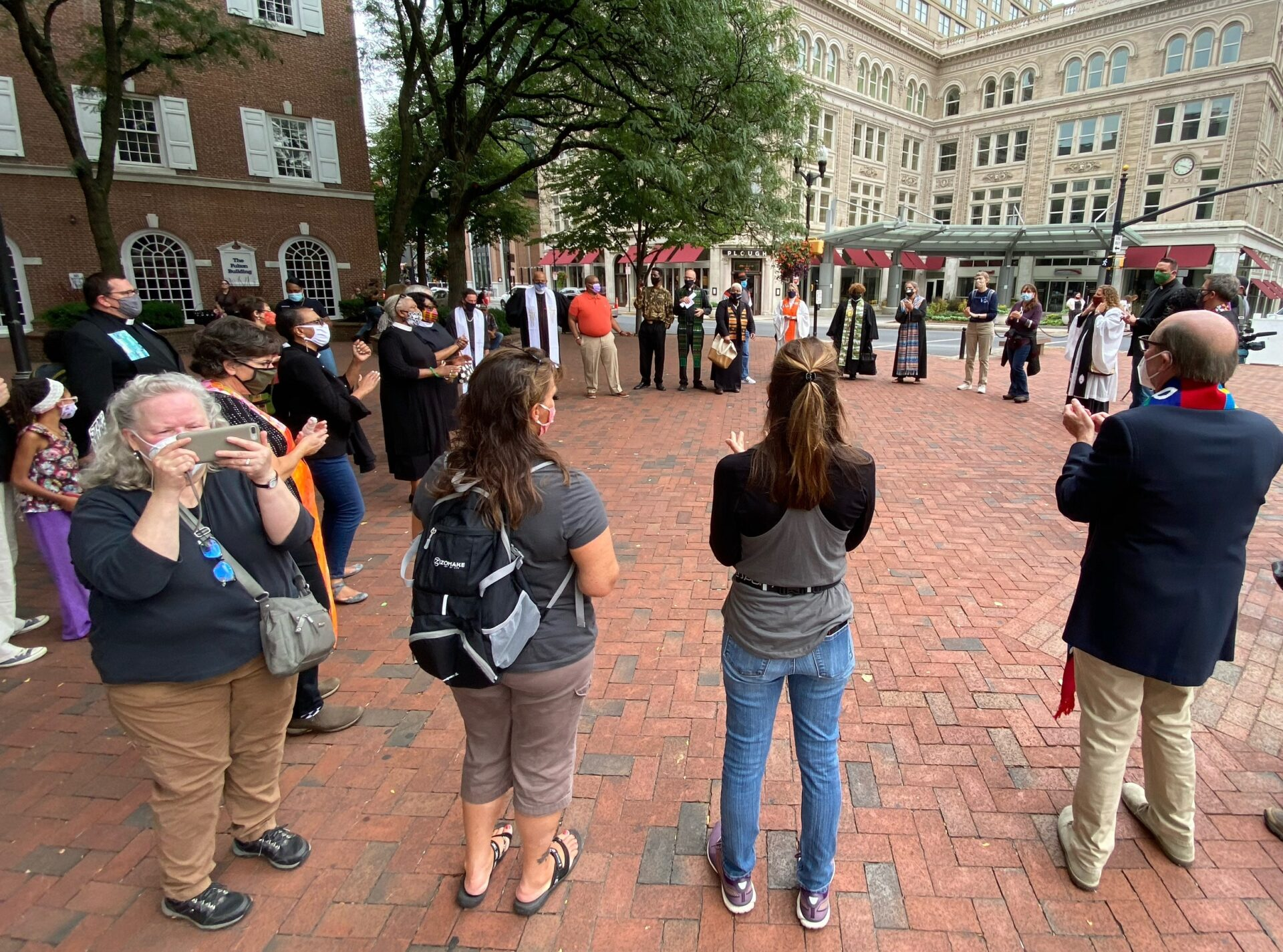 Participants form a circle in Penn Square outside Fulton Bank during a protest organized by POWER Interfaith Lancaster County on Thursday, Sept. 17, 2020. (Photo: Audrey Lilley)