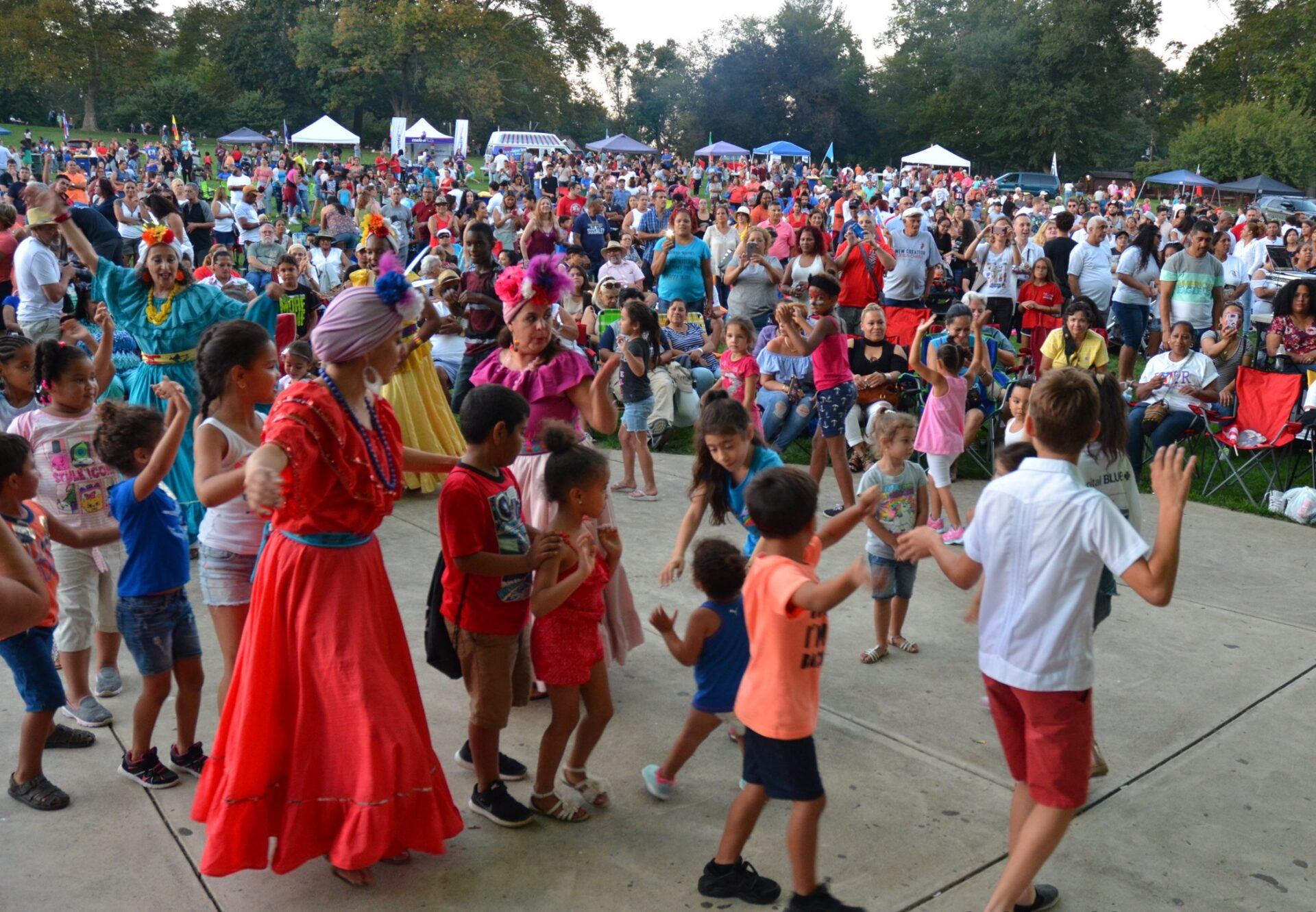 Performers and children dance at Longs Park in an undated photo from the Latin American Festival (Photo: Sollivan Photography | Courtesy of Latin American Alliance)