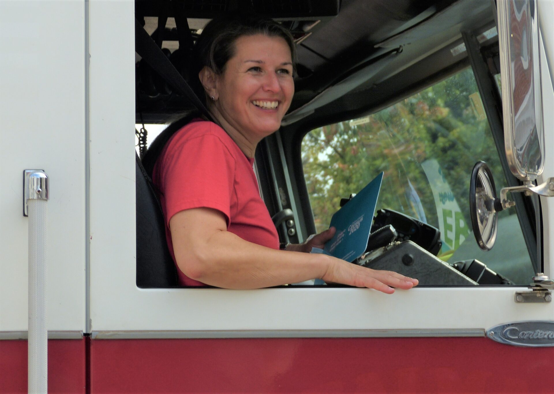Lancaster Mayor Danene Sorace smiles from the passenger seat of a fire truck as she rides through city neighborhoods for Census Emergency Day on Friday, Sept. 25, 2020. (Photo: Tim Stuhldreher)