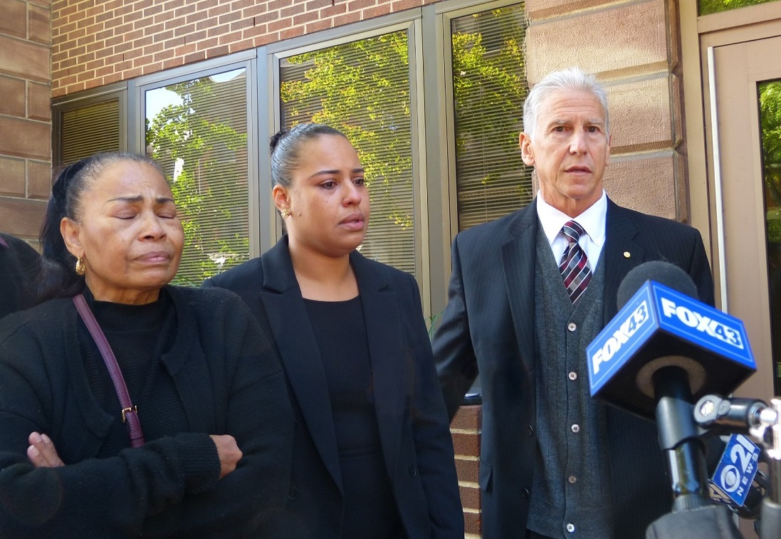 From left, Ricardo Munoz' mother Miguelina Pena,  his sister Rulennis Munoz, and attorney Michael Perna speak outside the County Courthouse on Wednesday, Oct. 14, 2020. (Photo: Tim Stuhldreher)