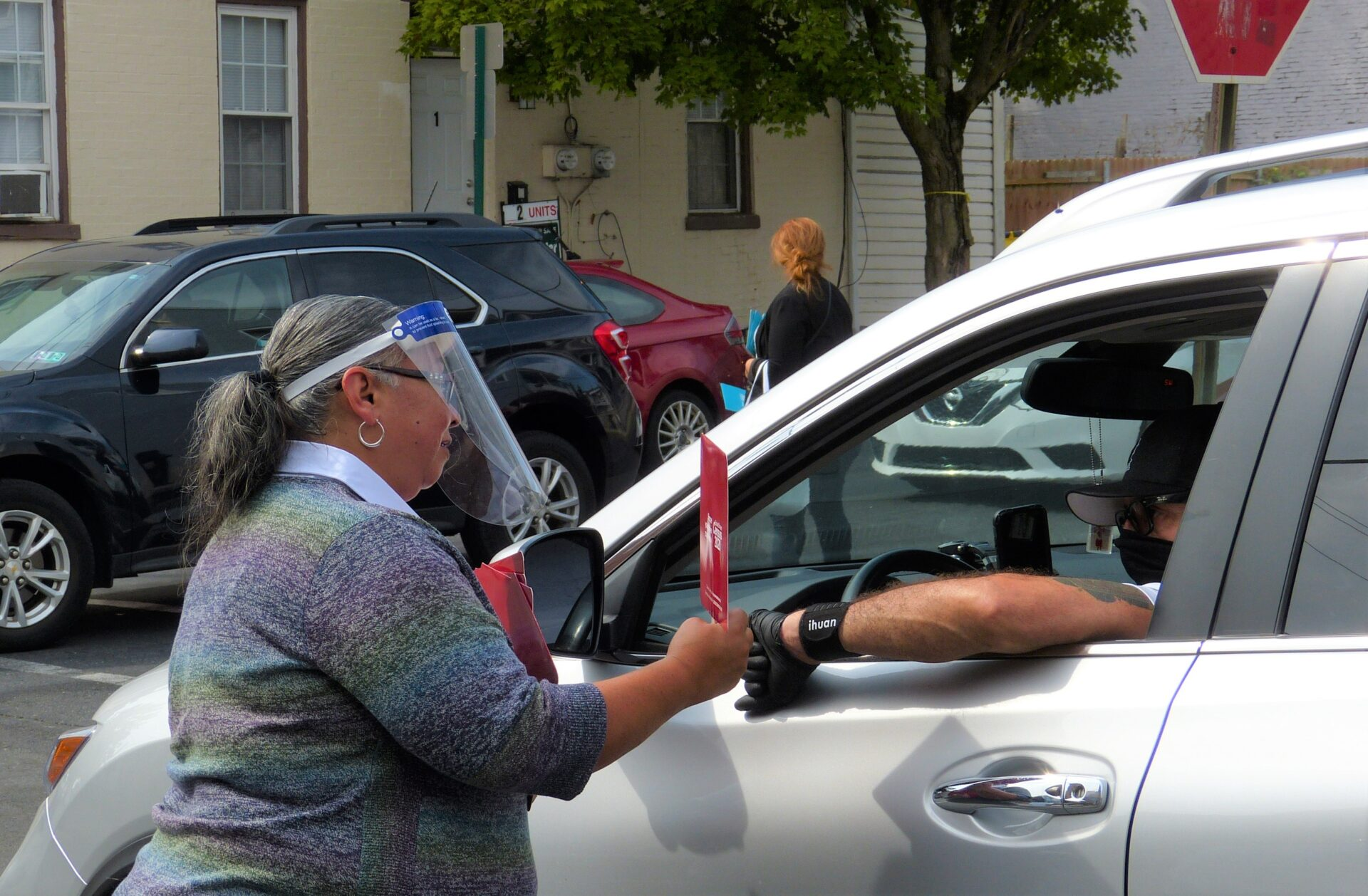 Volunteer Lori Pagan hands out Census materials at the corner of St. Joseph and New Dorwart streets in Lancaster on Friday, Sept. 25, 2020. (Photo: Tim Stuhldreher)