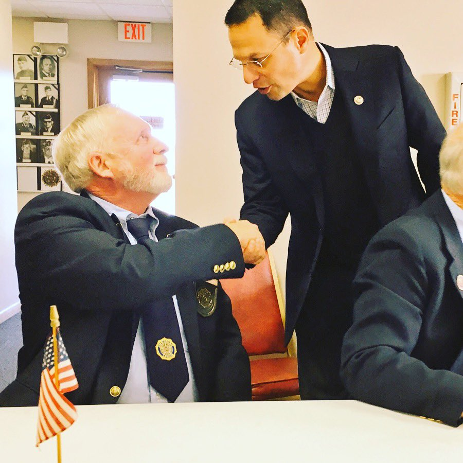 Pa. Attorney General Josh Shapiro, standing at right, greets a veteran during a Veterans Day observance. (Source: Josh Shapiro)