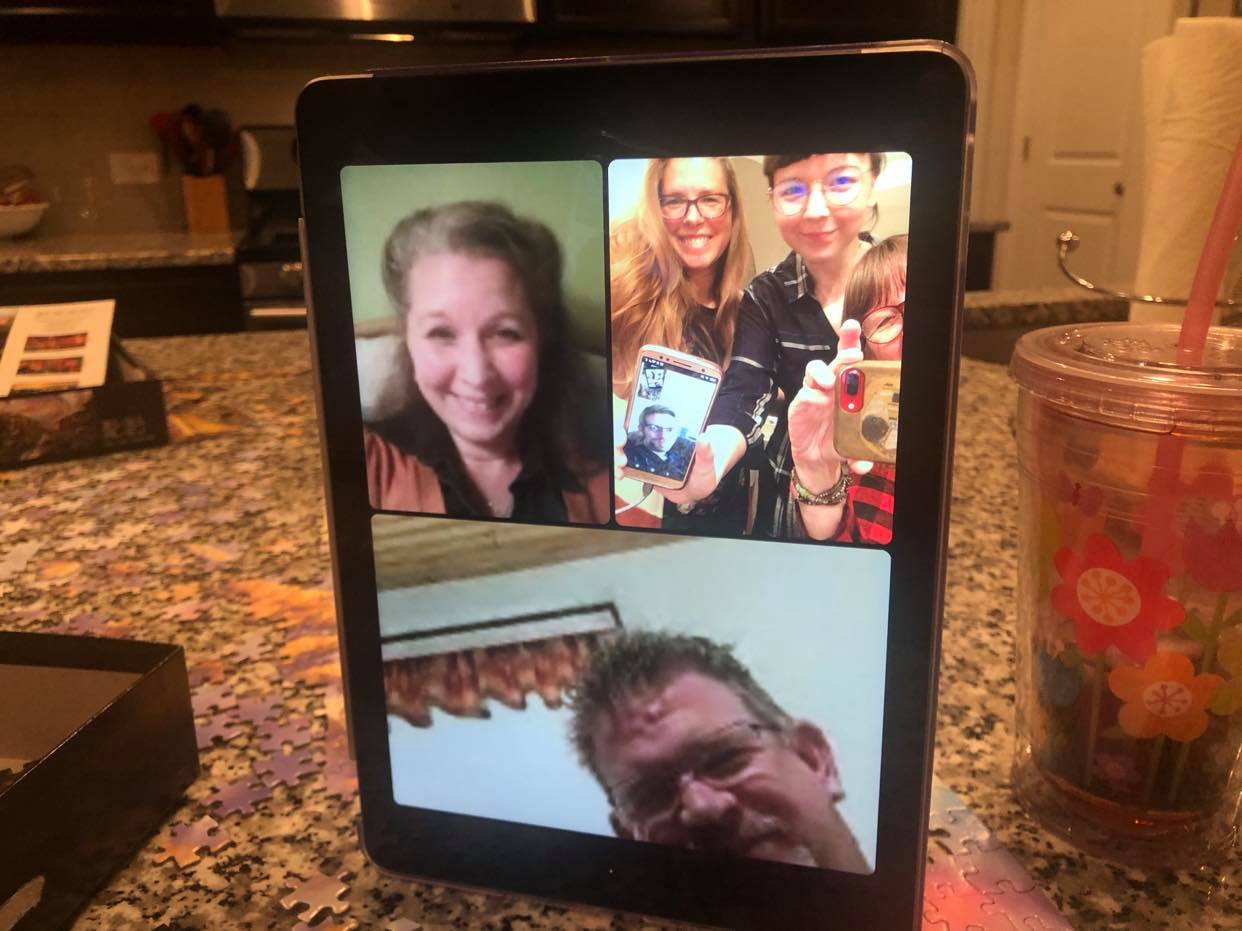 Heather Hutsell and her family share Thanksgiving on Thursday, Nov. 26, 2020. Clockwise from top left: Hutsell; her sisters Sarah and Laura; her mother, Nancy; and brother, Jeremy. Her brother Tim can be seen on Sarah's phone. (Source: Provided)