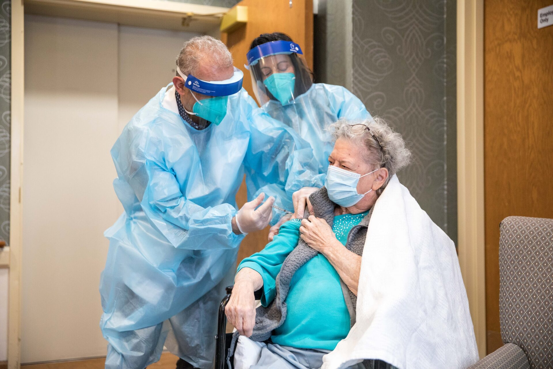 CVS personnel administer a Covid-19 vaccine at The Reservoir long term care facility in Hartford, Conn., on Friday, Dec. 18, 2020. (Source: CVS)