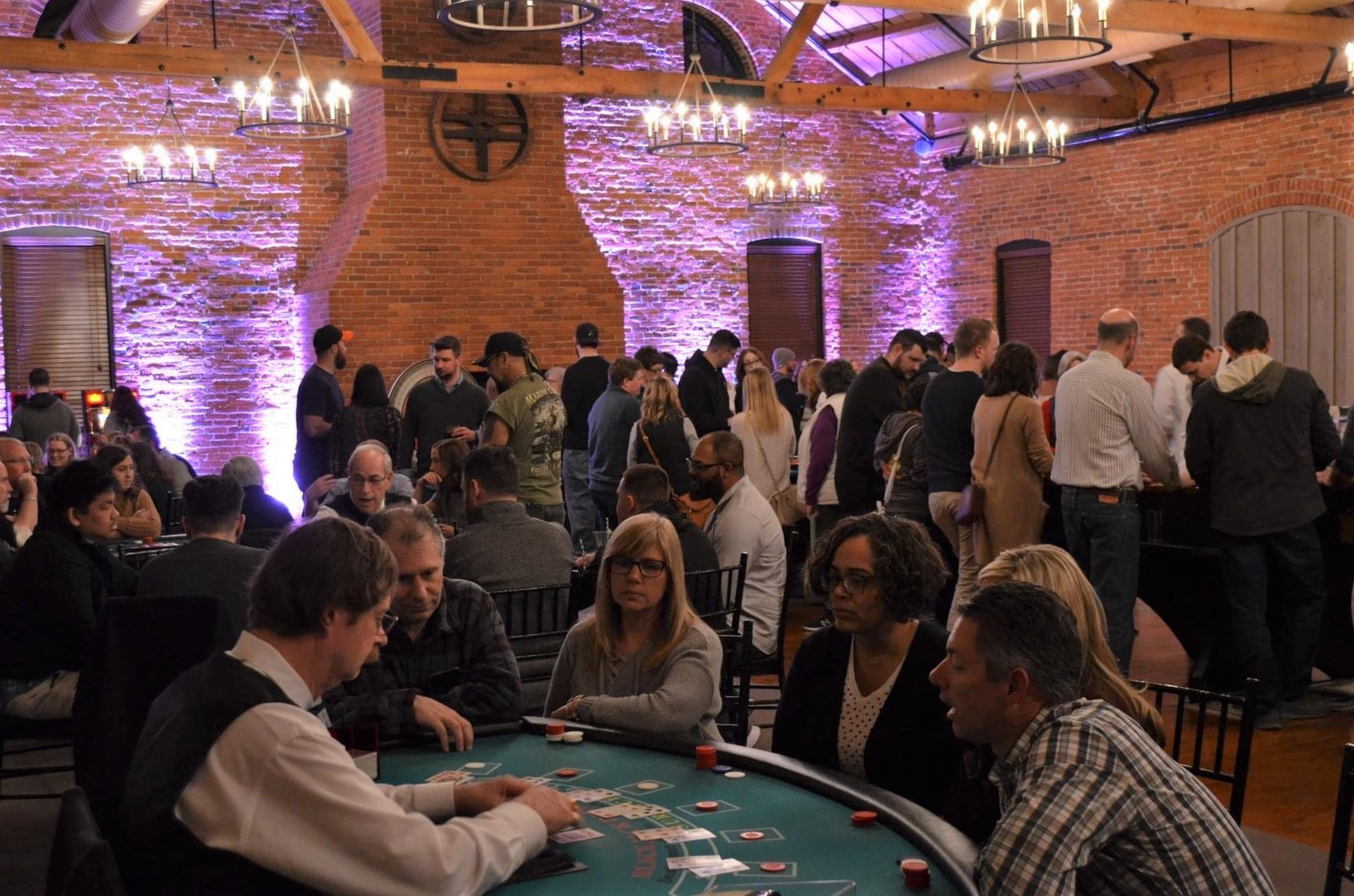 Players take part in a card game at a casino-themed fundraiser for The Mighty Mehal Foundation in February 2020. (Source: Provided)