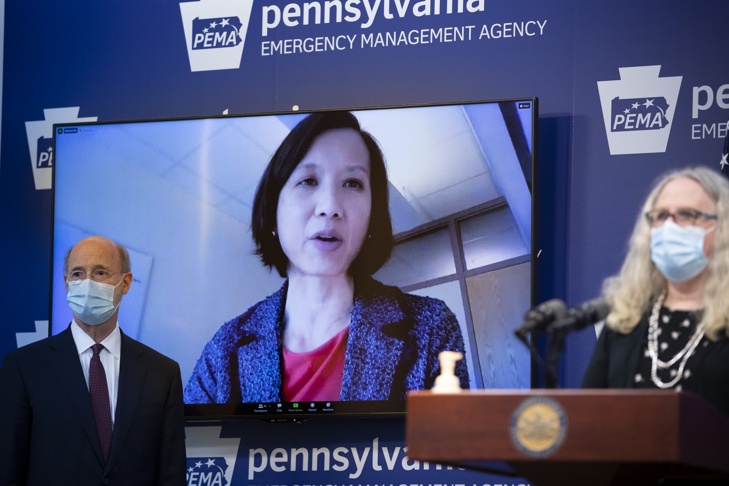 Flanked by Gov. Tom Wolf and Health Secretary Dr. Rachel Levine, Dr. Cynthia Chuang of Penn State Hershey Medical Center speaks via video link during an online state news briefing on Tuesday, Jan. 12, 2021.