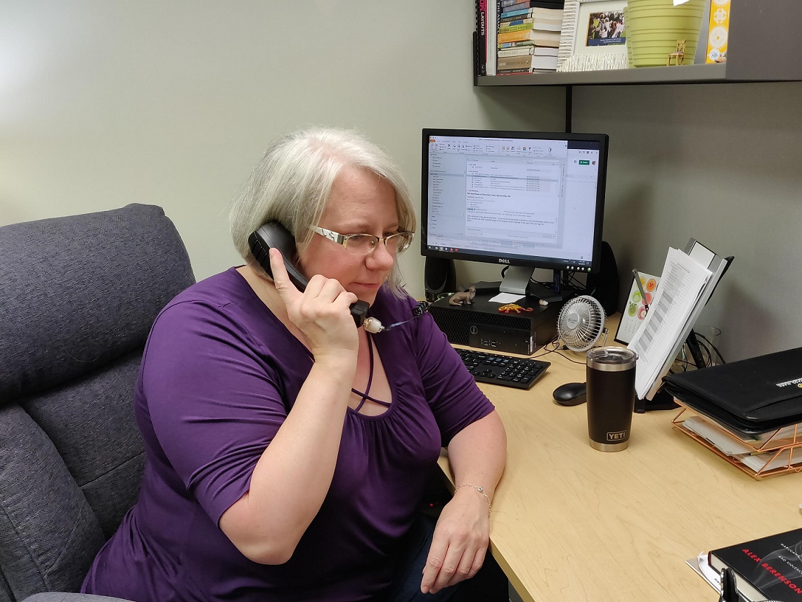 Amy Sechrist, certified prevention specialist, answering a call to Compass Mark's Addiction Resource Center. (Photo: Provided)