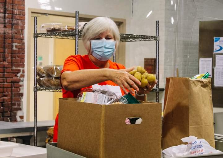 A volunteer packs a food box at the Lancaster County Food Hub. (Source: Provided)