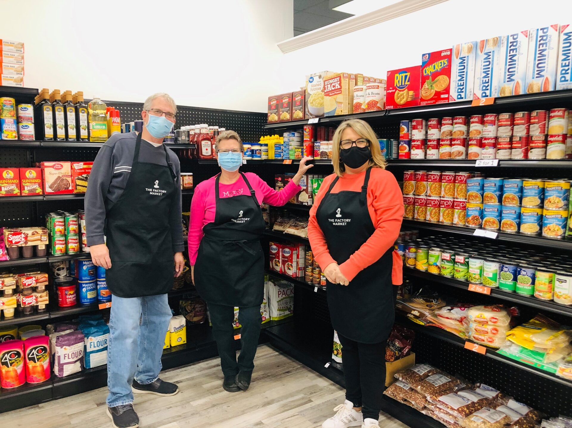 Volunteers Mike and Deb Sensenig join Factory Market director Kerri Burns, right, in the remodeled space. (Photo: Provided)