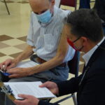 John Lines, director of LG Health's public relations and corporate communications, checks in with a patient after his vaccine. (Photo: Olivia Smucker)