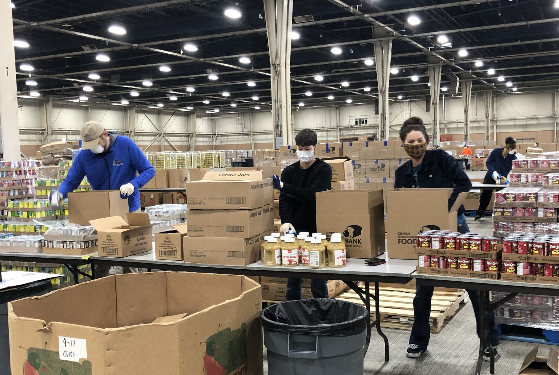 Volunteers pack boxes at the Central PA Food Bank distribution hub at the Farm Show complex. (Photo: Provided)