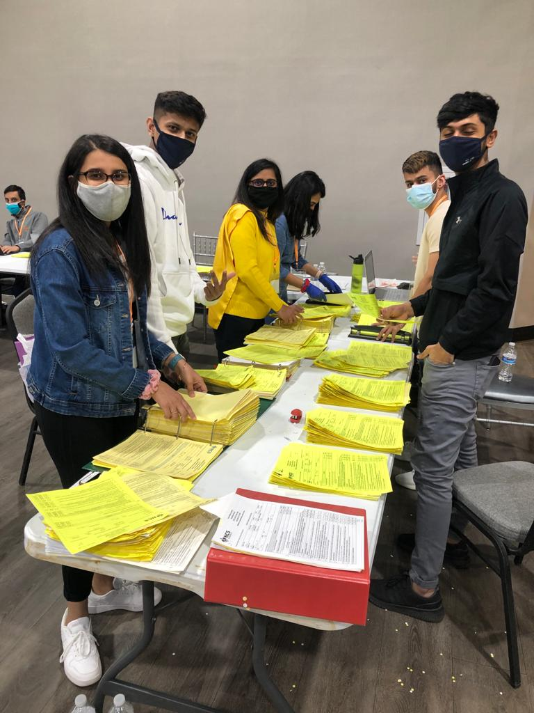 Volunteers handle patient paperwork at the SAAL/NCS Pharmacy Covid-19 vaccine clinic at the Wyndham Expo Center. (Source: Provided)