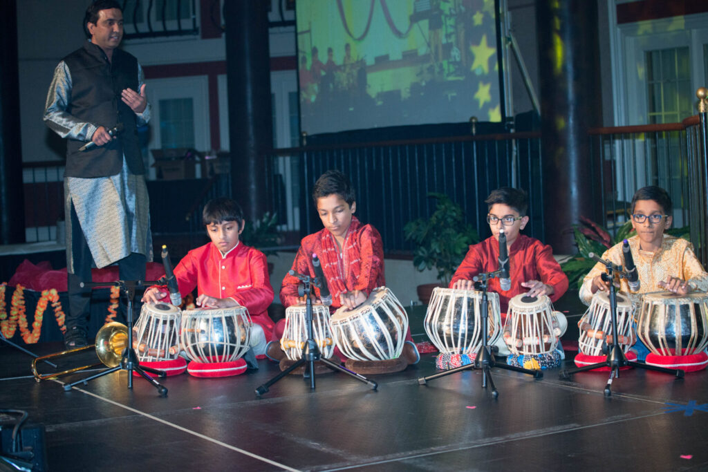 Children play drums as part of a SAAL Diwali (Festival of Lights) celebration. (Source: Provided)