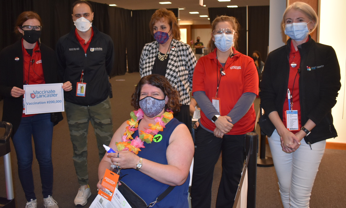 Sheri Yohe, seated, was the recipient of the 200,000th vaccine administered at the Lancaster County Community Vaccination Center, on Saturday, May 15, 2021. (Photo: Provided)