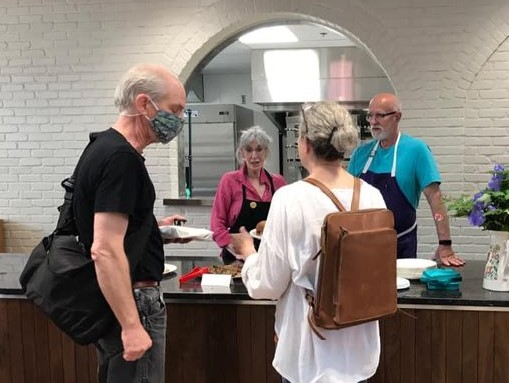 Ellen and Ed Diller at Gypsy Kitchen in Columbia Market House, talking with guests. (Source: Gypsy Kitchen)