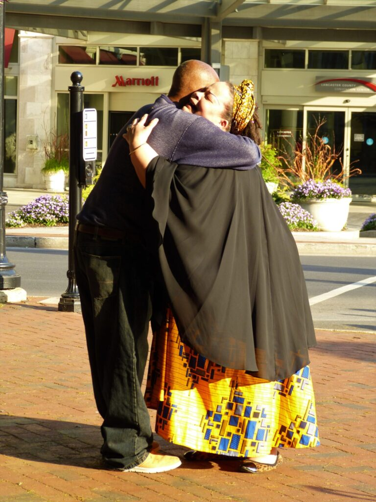 Tonya Maryoung-Cooke embraces a man as part of her performance. (Photo: Olivia Smucker)