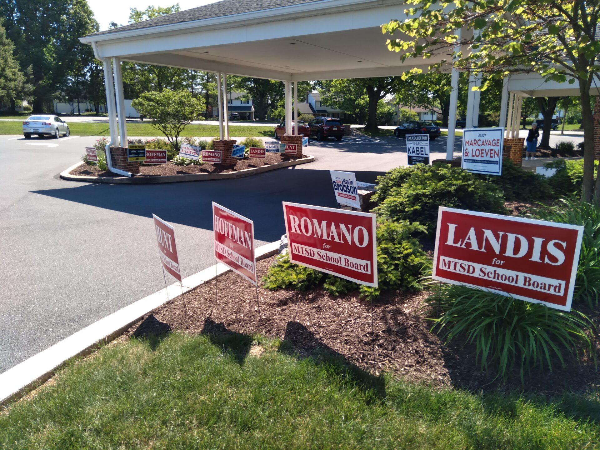 Numerous campaign signs await voters outside the Lancaster Township 9D polling place at Lancaster Church of the Brethren, 1601 Sunset Ave., on Tuesday, May 18, 2021. (Photo: Tim Stuhldreher)