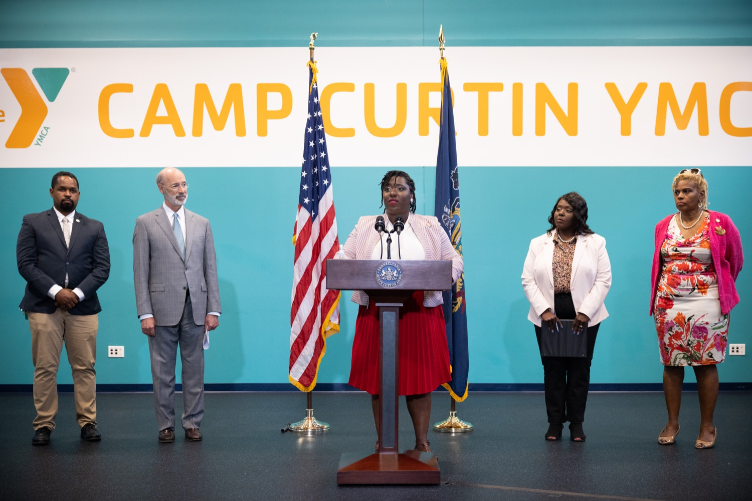 State Rep. Joanna McClinton, House Democratic Caucus Leader, speaks about voting rights during a press conference at the Camp Curtin YMCA in Harrisburg on Wednesday, June 9, 2021. She is flanked by, from left, state Sen. Sharif Street; Gov. Tom Wolf; acting Secretary of State VeronicaDegraffenreid and state Rep. Margo Davidson. Street and Davidson are the Democratic chairs of their respective chambers' State Government committees.  (Source: Pa.gov)