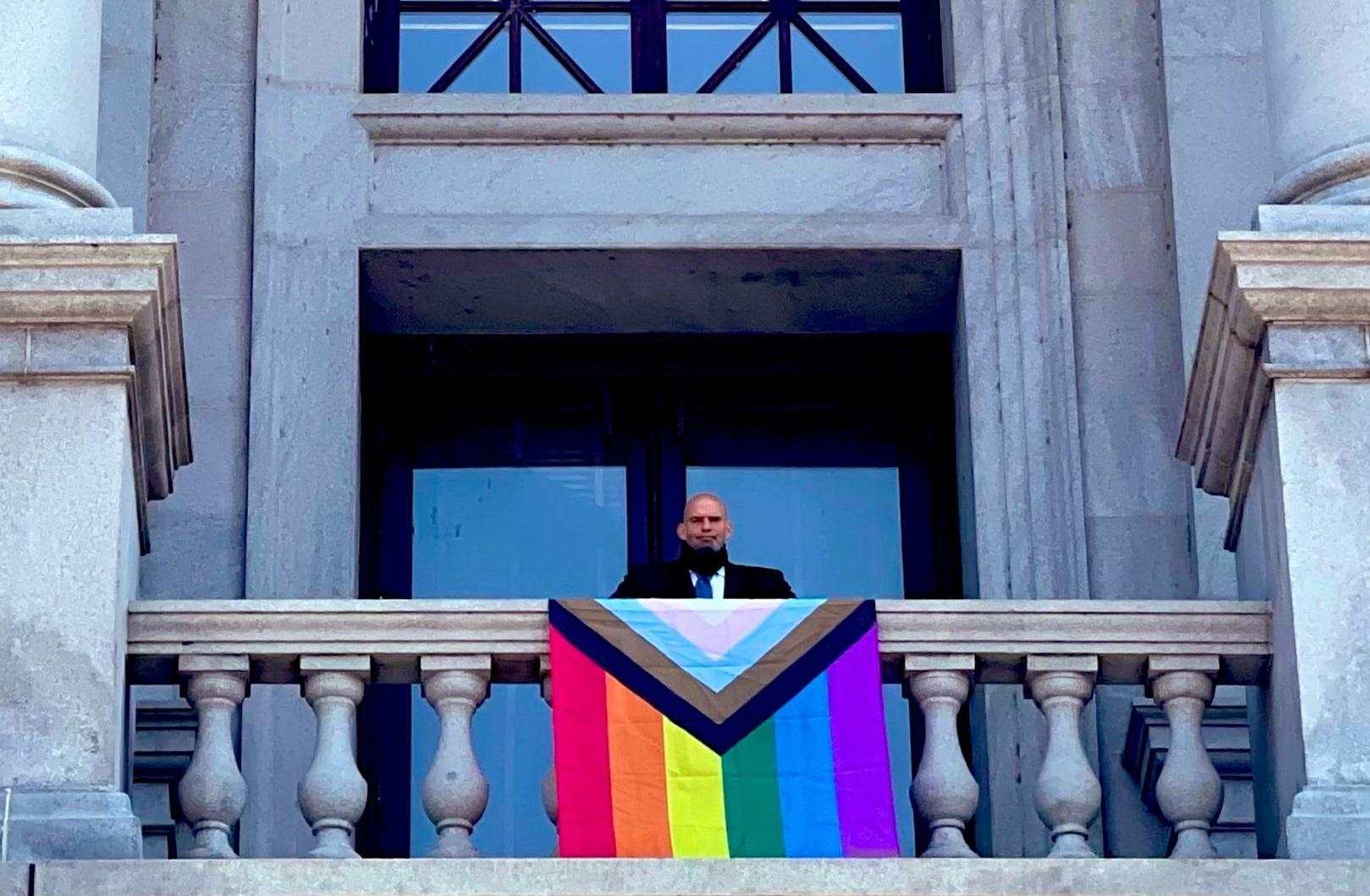 Pa. Lt. Gov. John Fetterman poses with a Pride flag outside his office at the state Capitol on Tuesday, June 1, 2021. (Source: @JohnFetterman)