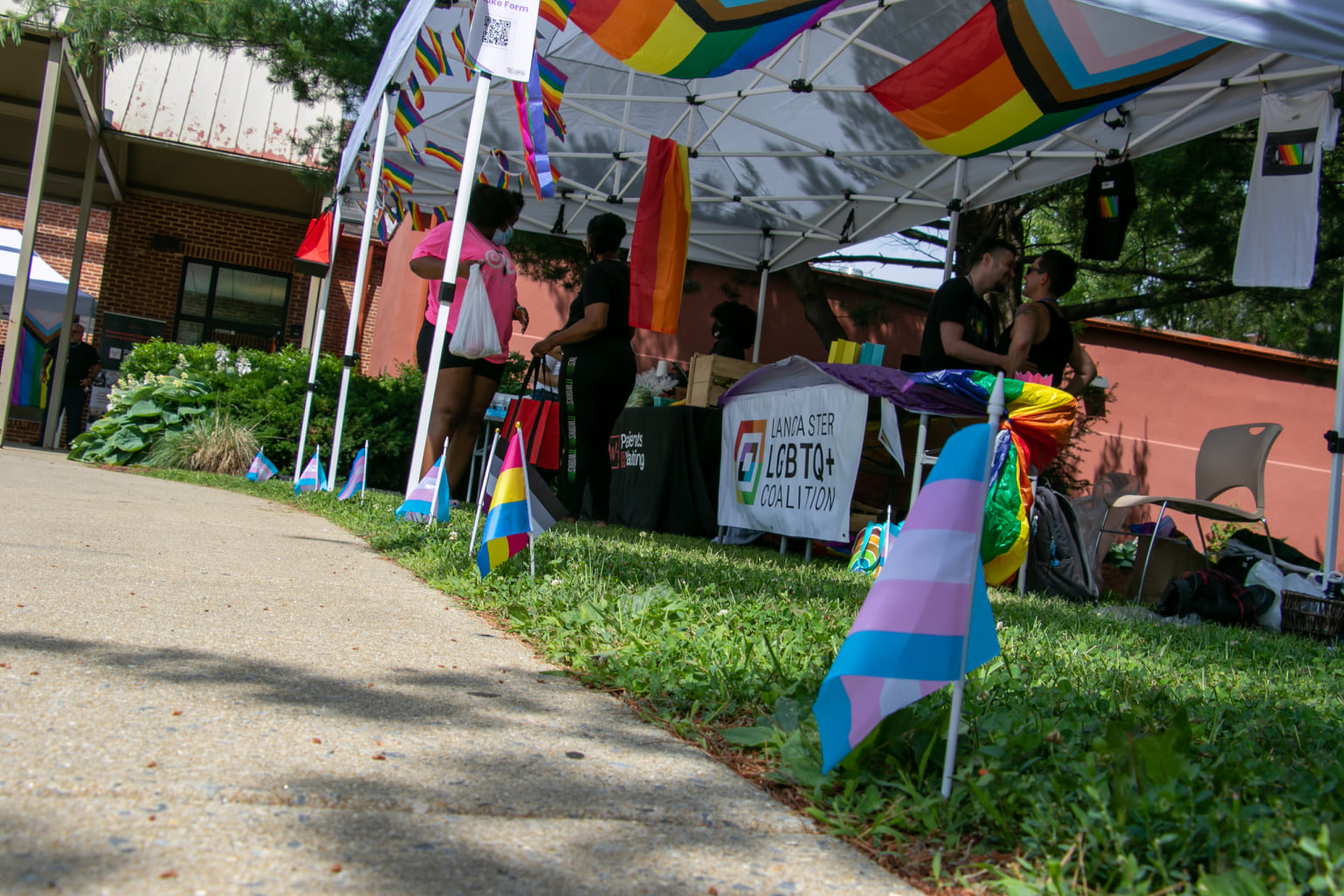 """Participants in the LGBTQ+ Vaccine Clinic """"Vogue, Vaccines & Visibility"""" check out the materials at the Lancaster LGBTQ's table on Saturday, June 12, 2021. (Source: Lancaster LGBTQ+ Coalition)"""