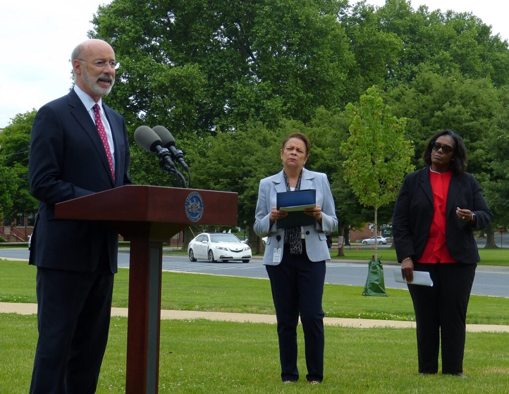 Gov. Tom Wolf speaks about charter school reform as School District of Lancaster Superintendent Damaris Rau and SDL school board vice president Robin Goodson look on at J.P. McCaskey High School on Tuesday, June 1, 2021. (Photo: Tim Stuhldreher)