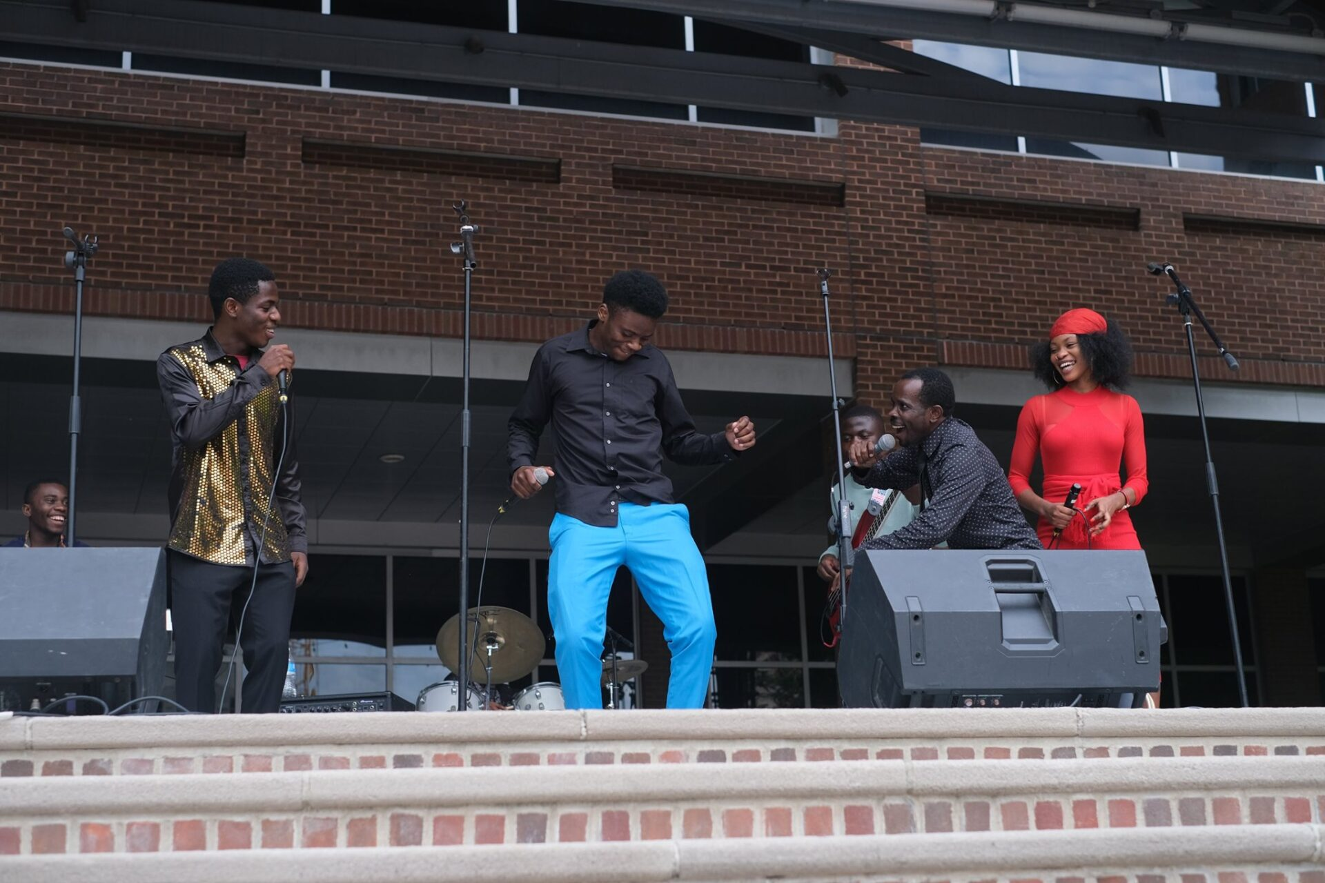 Joel Makeci (crouching, second from right) and NGGBC, the musical act during Music For Everyone's Music Friday in honor of World Refugee Day on June 23. (Source: Church World Service)