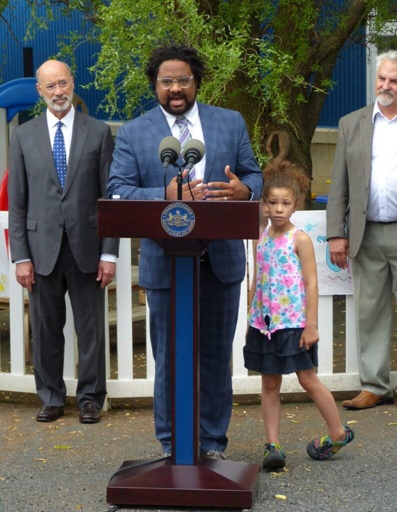 Joined by his daughter, Acacia, 7, Kevin Ressler, President and CEO of United Way of Lancaster County, discusses early childhood education at Community Action Partnership of Lancaster County on Thursday, July 8, 2021. In the background are Gov. Tom Wolf and state Rep. Mike Sturla. (Photo: Tim Stuhldreher)