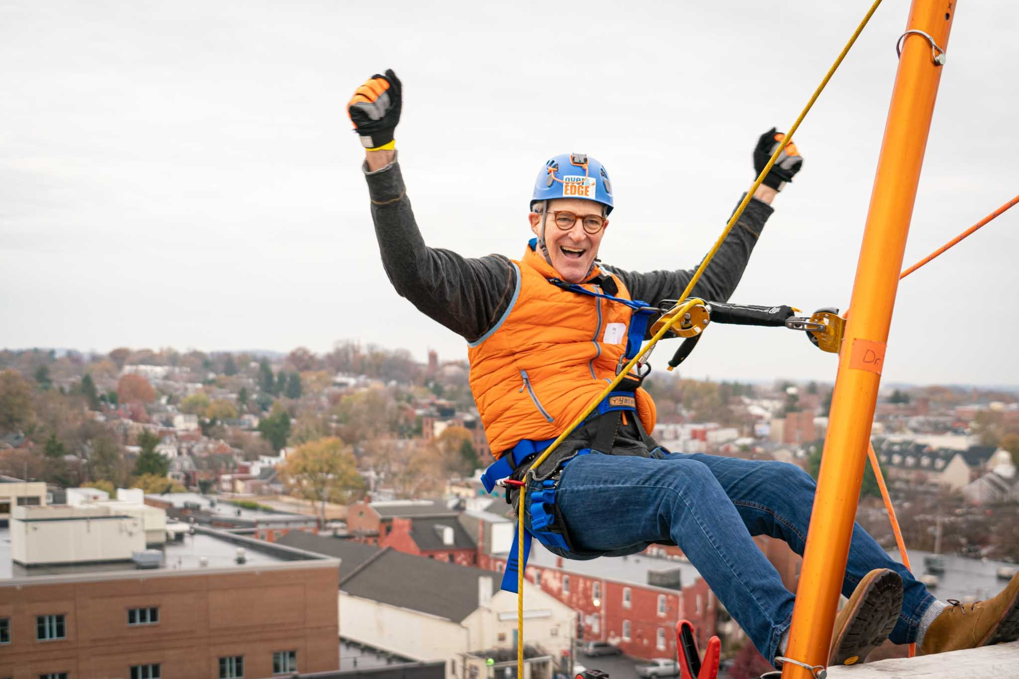 An Eye Drop participant prepares to head down the side of the Holiday Inn Lancaster. (Soure: VisionCorps)