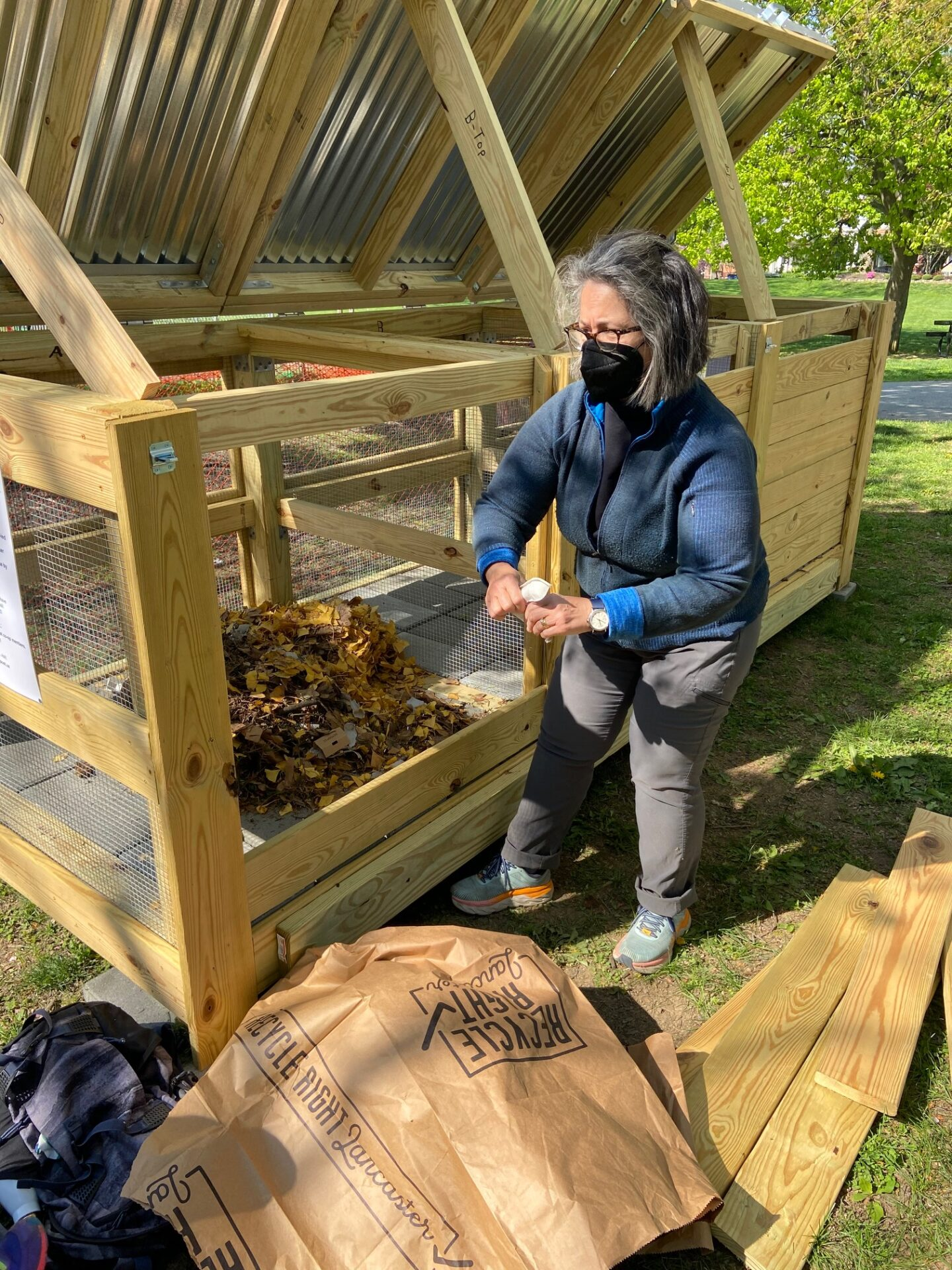 Compost Captain Antonia Hinnenkamp preparing the initial stages of the Musser Park composting bin. (Source: Lancaster Compost Co-Ops)
