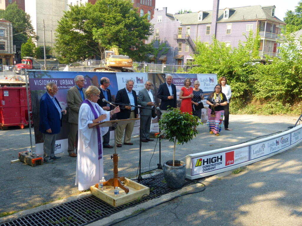 Flanked by representatives of Landis Communities and its project and community partners, the Rev. Elizabeth Soto Albrecht conducts a Blessing the Ground Ceremony for Landis Place on King on Wednesday, June 7, 2021. (Photo: Tim Stuhldreher)