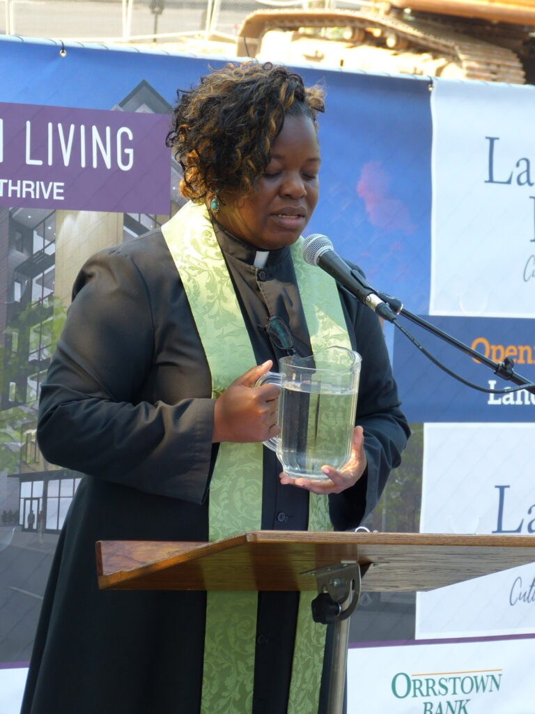 The Rev. Shayna Watson prays during a libation ceremony for Landis Place on King on Wednesday, July 7, 2021. (Photo: Tim Stuhldreher)