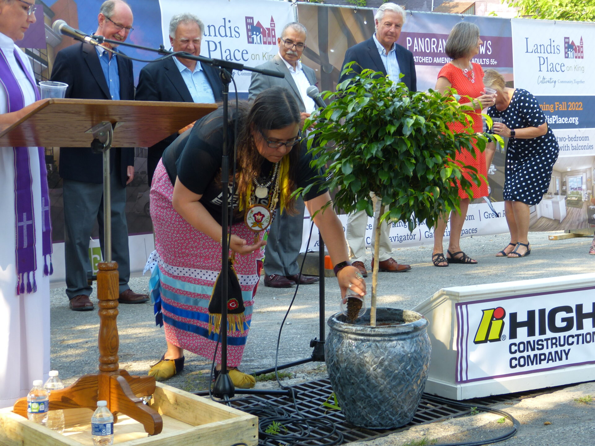 Jess McPherson, a Native American and board member of Circle Legacy Center, sprinkles dirt around a Peace Tree during a dedication and blessing ceremony for Landis Place on King on Wednesday, July 7, 2021. (Photo: Tim Stuhldreher)