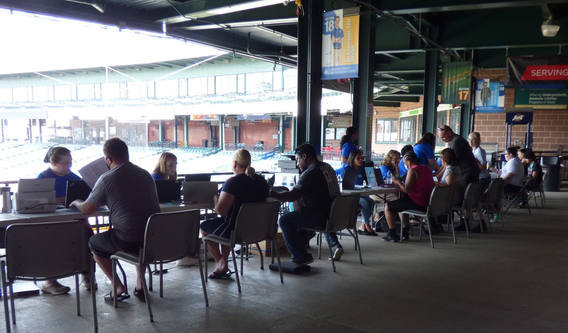 Staff from the Lancaster County Redevelopment Authority and local nonprofits assist clients with Emergency Rental Assistance Program applications at the Rental & Utility Assistance Community Days event at Clipper Magazine Stadium in Lancaster on Friday, July 23, 2021. (Photo: Tim Stuhldreher)
