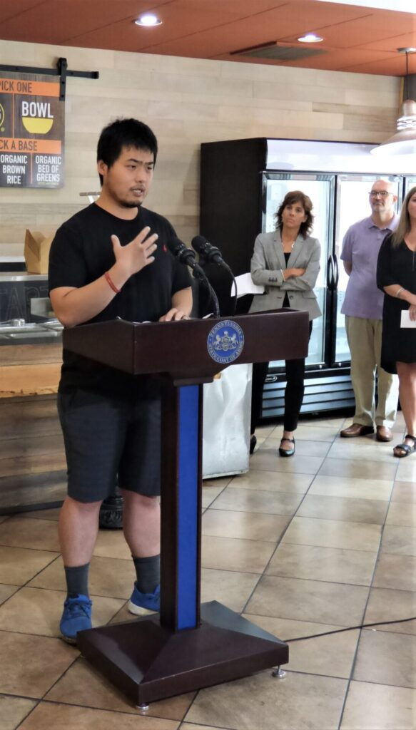 Silantra Asian Street Kitchen owner Sam Guo speaks at a press conference on Monday, July 26, 2021. In the background are Lisa Riggs, president, Economic Development Co. of Lancaster County; County Commissioner Craig Lehman; and Heather Valudes, vice president, Lancaster Chamber. (Photo: Tim Stuhldreher)