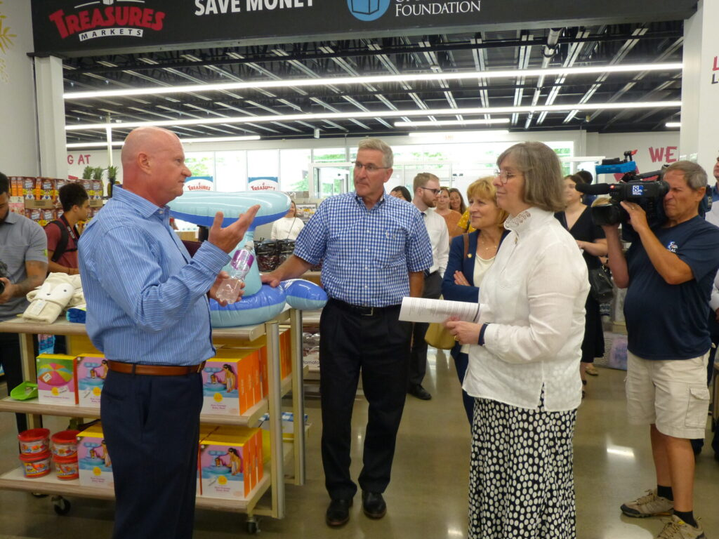 Treasures Markets founder, left, explains the history of the enterprise to, from left, Agriculture Secretary Russell Redding, state Sen. Judy Schwank and Pa. First Lady Frances Wolf during a tour on Monday, July 19, 2021. (Photo: Tim Stuhldreher)