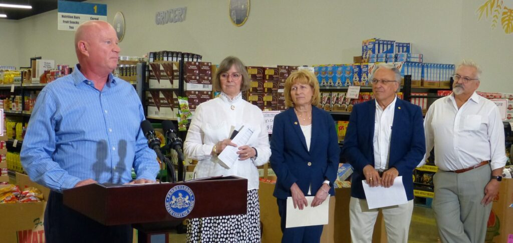 Treasures Markets founder Mike Mitchell speaks at a news conference at the business on Monday, July 19, 2021. Behind him are, from left, Pa. First Lady Frances Wolf, state Sen. Judy Schwank, state Rep. Eddie Day Pashinski and state Rep. Mike Sturla. (Photo: Tim Stuhldreher)