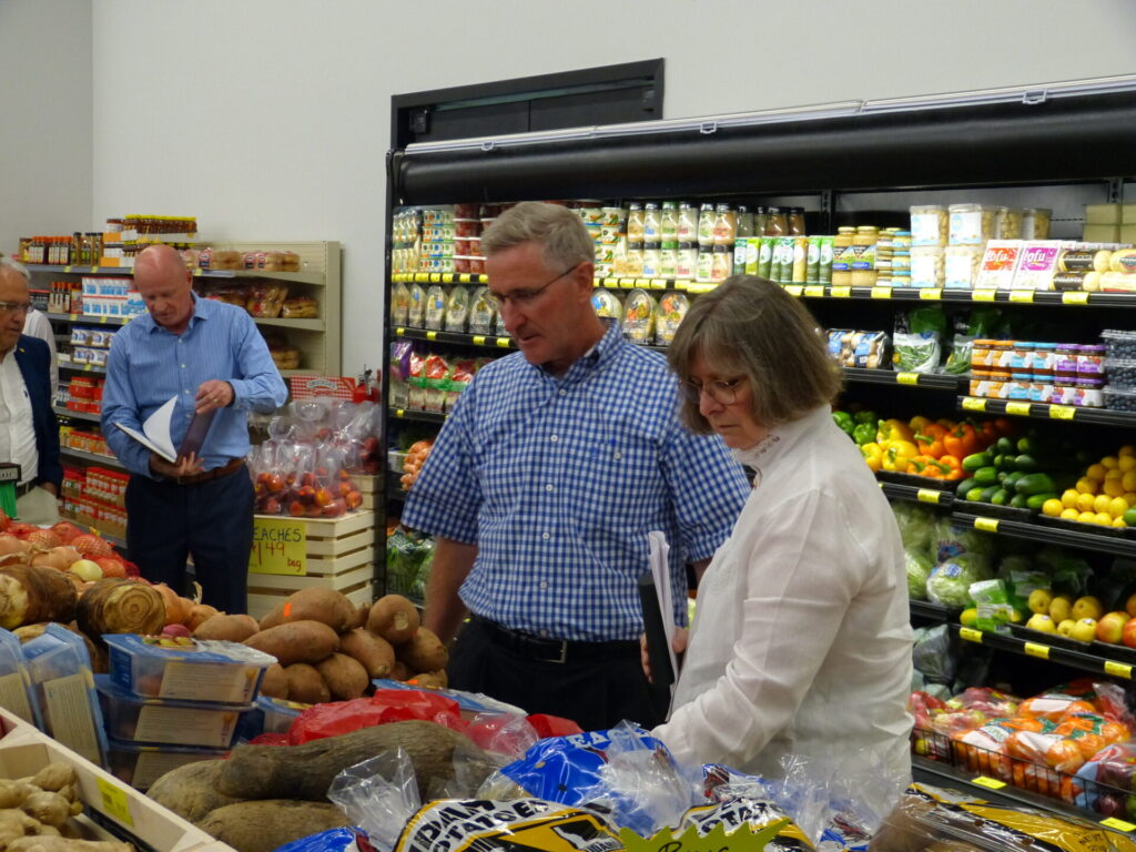 Agriculture Secretary Russell Redding and Pa. First Lady Frances Wolf take a look at the fresh vegetables for sale at Treasures Markets on Monday, July 19, 2021. (Photo: Tim Stuhldreher)