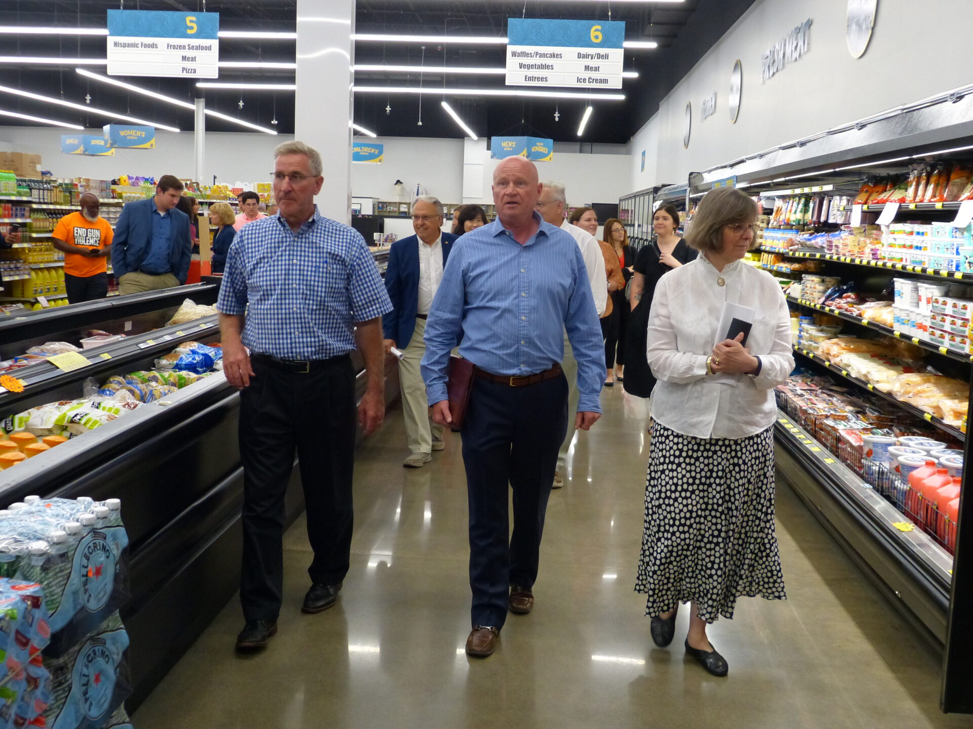 In foreground, from left, Agriculture Secretary Russell Redding, Treasures Markets founder Mike Mitchell and Pa. First Lady Frances Wolf walk through Treasures Markets in Lancaster during a tour on Monday, July 19, 2021. (Photo: Tim Stuhldreher)